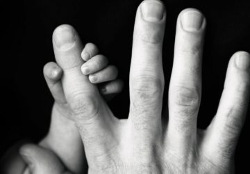 man and child hands