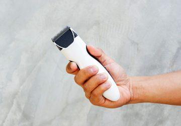 a man holding a razor