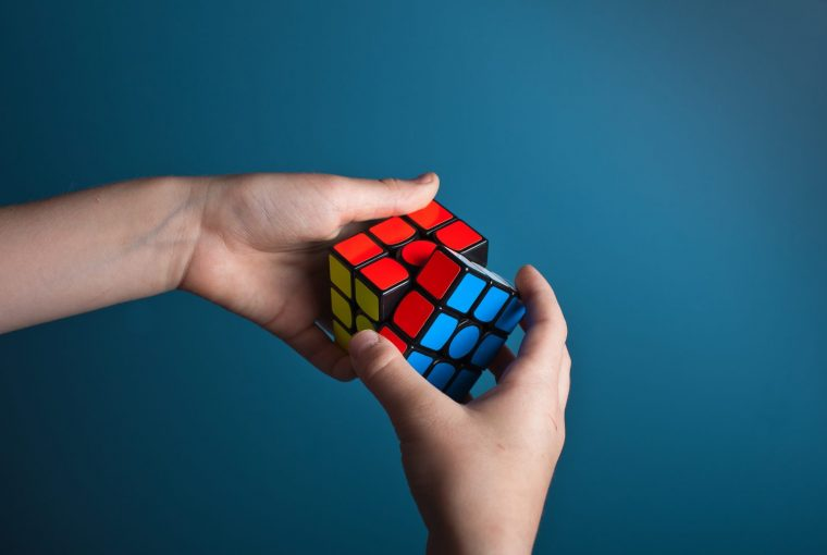 a person using a rubics cube