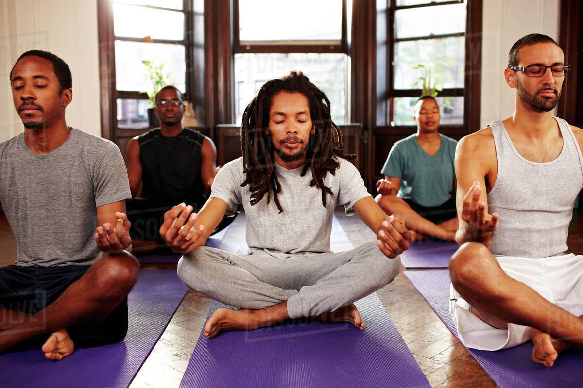 a group of men meditating