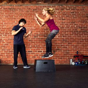 a trainer and a client working out