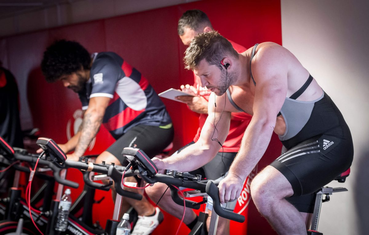 men in a spin class