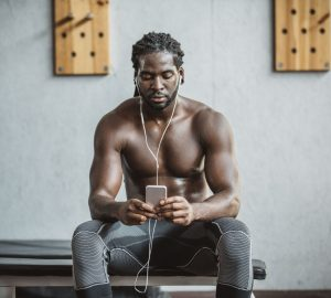 a fit man listening to music