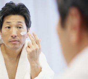 a man applying skincare