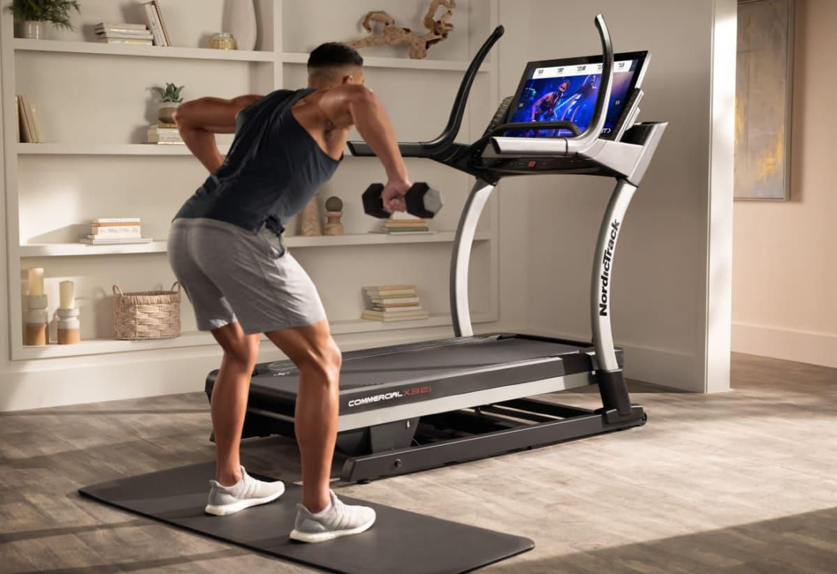 a man exercising in front of a treadmill
