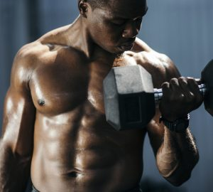 Men doing biceps curl in gym.