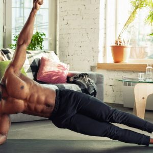 a man doing a side plank